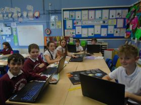 P6 and P7 class getting to use our new laptops!!